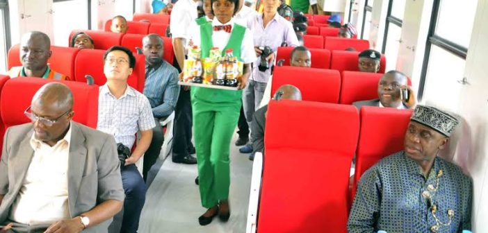 PIC. 1. MINISTER OF TRANSPORTATION, MR CHIBUIKE AMAECHI (R); DIRECTOR OF RAIL TRANSPORTATION, MR MOHAMMED BABAKOBI (L), AND OTHER PASSENGERS TEST-RIDING IN THE FIRST CLASS COACH OF THE ABUJA-KADUNA TRAIN SERVICE FROM IDU MAIN STATION TO KUCHBUN AT KUBWA IN ABUJA ON WEDNESDAY (1/6/16). 3950/1/6/2016/BJO/NAN