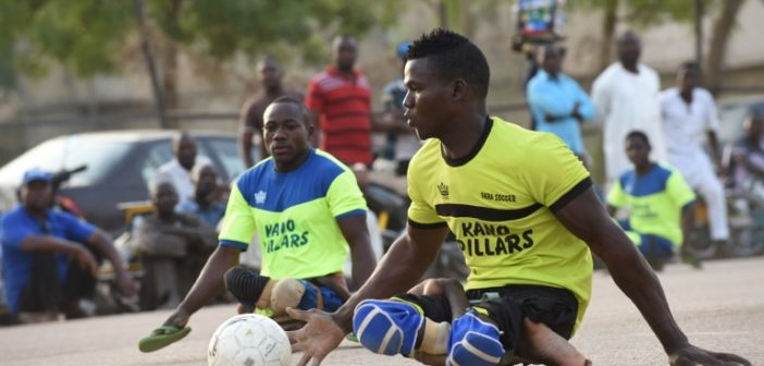"""Kano Pillars para-soccer team player advances with the ball during a training session in Kano, northwestern Nigeria, on April 22, 2017. The World Health Organization said 116 million children are to receive polio vaccines in 13 countries in west and central Africa as part of efforts to eradicate the disease on the continent. """"The synchronised vaccination campaign, one of the largest of its kind ever implemented in Africa, is part of urgent measures to permanently stop polio on the continent,"""" the WHO said.  / AFP PHOTO / PIUS UTOMI EKPEI"""