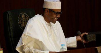 Muhammadu Buhari laughing