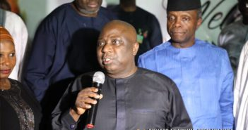 The-Celebrant-Dapo-Olorunyomi-delivering-vote-of-thanks-with-his-friend-around-him