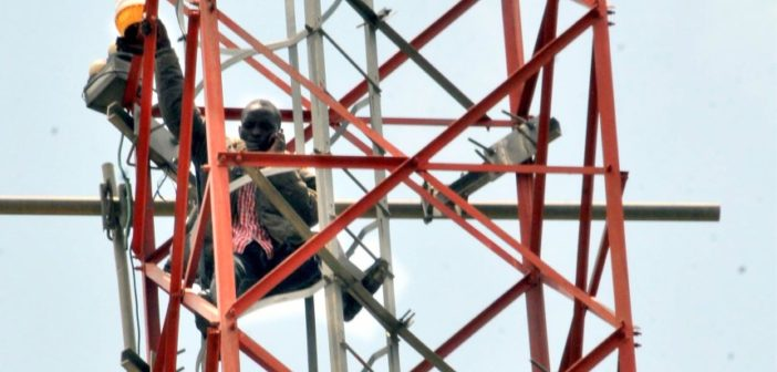 Man-climbs-Mast