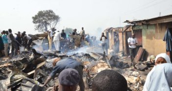 Traders at scene of fire incidence at Abubakar Gumi Central Market in Kaduna on Wednesday (20/2/2019)