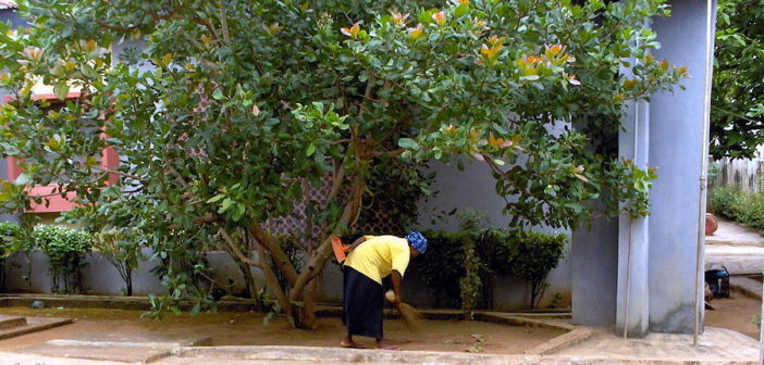 nigerian-woman-sweeping-dirt